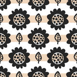 Repeated abstract silhouettes of flowers and leaves. Seamless pattern. Royalty Free Stock Photo