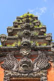 Repeated Balinese sculptures vertical Stock Images