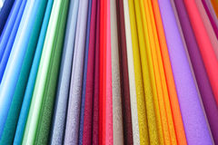 Repeated colours. Colourful fabric on display at market Stock Image