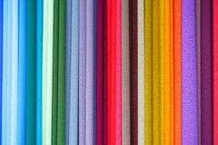 Repeated colours. Colourful fabric on display at market Stock Photos