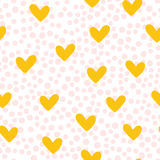 Repeated cute hearts. Polka dot. Seamless pattern. Drawn by hand. Stock Images