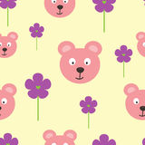 Repeated heads of funny bears and flowers with hearts. Cartoon seamless pattern. Stock Photo