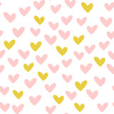 Repeated hearts. Drawn by hand. Romantic seamless pattern. Stock Photos