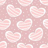 Repeated polka dots and cute hearts. Romantic seamless pattern. Stock Image