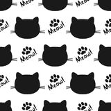 Repeated silhouettes of cat heads and paws. Lettering Meow! Seamless pattern. Vector illustration. Black, white color Stock Photos