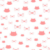 Repeated silhouettes of a cat`s head and bows. Seamless pattern. Vector illustration. White, pink Royalty Free Stock Photos
