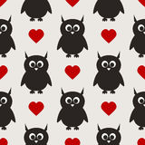 Repeated silhouettes of owls with ears and hearts. Stock Photo