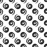 Repeated spirals drawn with a brush. Seamless pattern. Royalty Free Stock Photography