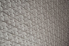 Repeated tiles on the ceiling. Texture of the ceiling Stock Image
