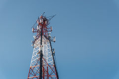 Repeater tele communication tower with blue sky on background. Cell phone tower Royalty Free Stock Image