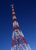 Repeater tower. High repeater tower on blue sky background Royalty Free Stock Photos