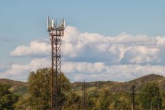 Tower with antennas of cellular communication. Repeaters. A tower with the antennas strengthening a signal of the cellular communication standing in the private Royalty Free Stock Images