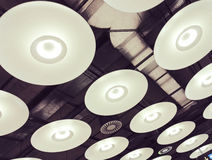 Repeating circular light fittings Stock Photo