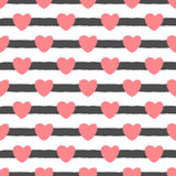 Repeating cute hearts on a striped background. Drawn by hand. Seamless pattern. Royalty Free Stock Photography