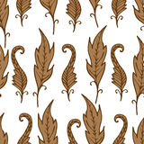 Repeating floral and feather pattern. Seamless texture with brown leaves. Royalty Free Stock Photo
