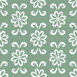 Repeating ornament of flowers and curls. Seamless pattern. Stock Images