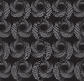 Repeating ornament of  textured circles on dark gray Royalty Free Stock Photography