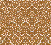 Repeating pattern on a brown. seamless wallpaper Stock Photo