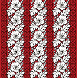 Hawaiian Floral Pattern Red and White. A repeating pattern of classic Hawaiian hibiscus Royalty Free Stock Image