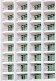 Repeating pattern of windows and balcony. Stock Photos