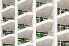 Repeating pattern of windows and balcony. Bulding front Stock Photography