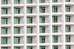 Repeating pattern of windows and balcony. Bulding front Stock Image
