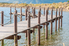 Repeating pattern of wooden poles Stock Photography