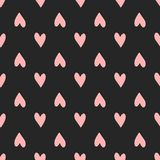 Repeating pink hearts on black background. Cute seamless pattern. Girly endless print. Romantic vector illustration royalty free illustration