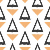 Repeating silhouettes and outlines of triangles. Painted by hand rough brush. Seamless pattern. Royalty Free Stock Photo