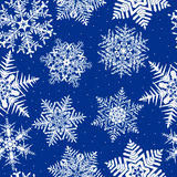 Repeating Snowflake Background. A Seamless Repeating Snowflake Background Royalty Free Stock Photos