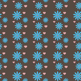 Repeating texture of flowers and hearts. Seamless pattern. Pink, blue, brown Royalty Free Stock Photos
