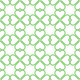 Repeating vector green clovers pattern Stock Photos