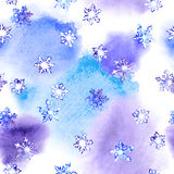 Repeating winter pattern with snowflakes on blotch watercolour Royalty Free Stock Photography