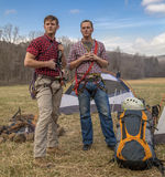 Repellers at the campsite. Repellers with rope looking and planning royalty free stock photos