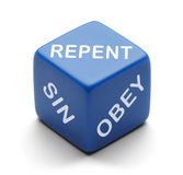 Repent Dice. Blue Dice with Repent Sin and Obey on it Isolated on a White Background Royalty Free Stock Photo