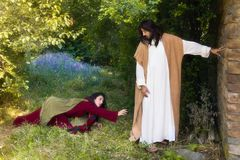 Touching Jesus robe. Repentant sinner women touching the robe of Jesus, asking for forgiveness and healing stock photo