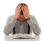 Repenting praying man read Bible. Holding head hands royalty free stock photo