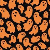 Repetition för orange spöke för allhelgonaaftontema slumpmässig på svart bakgrund royaltyfria foton