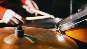 Repetition. Girl playing drums. Only hands shown stock video footage