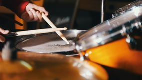 Repetition. Girl playing drums in the studio. Only hands shown. Drum kit close up stock video