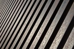 Diminishing perspective of steel bars. Repetition pattern of rusty bars of steel. Diminishing perspective royalty free stock photography