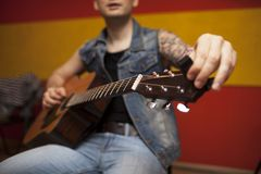 Repetition of rock music band. Cropped image of electric guitar player. Rehearsal base stock images