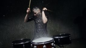 Photo shoot crazy drummer in the rain stock footage