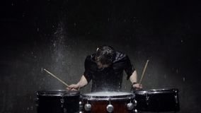 Photo shoot crazy drummer in the rain stock video