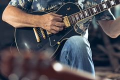 Repetition of rock music band. Electric guitar player and drummer behind the drum set. Repetition of rock music band. Bass guitar player, electric guitar player royalty free stock images