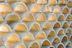 Repetition of small arches made of concrete, used as building wall decoration, background Royalty Free Stock Image