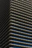 Repetitive horizontal louvers. Exterior facade with multiple repetitive horizontal louvers and windows Royalty Free Stock Photography