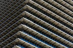 Repetitive horizontal louvers. Exterior facade with multiple repetitive horizontal louvers and windows Stock Photography