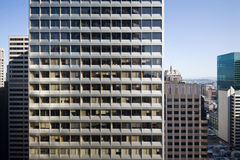 Repetitive modern facade. The facade of an office tower suggests the repetition of modern corporate life Stock Photo