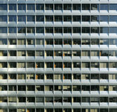 Repetitive modern facade. The facade of an office tower suggests the repetition of modern corporate life Stock Photos
